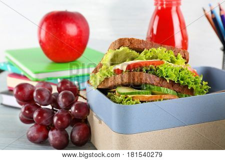 Meal for schoolchild in lunch box on table