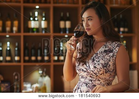 Gorgeous Chinese woman drinking high quality wine