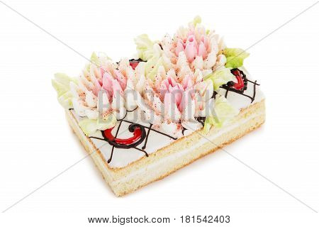 Biscuit Cake Decorated With Cream Flowers Isolated On White