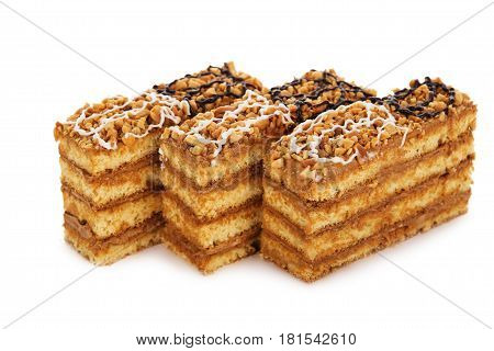 Peanut Cake Decorated With Cream Icing Isolated On White