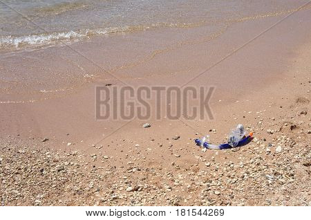 The sand on the seashore and mask with snorkel