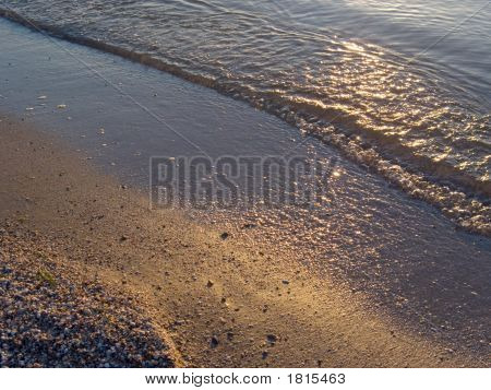 Sand, Water And Sunset