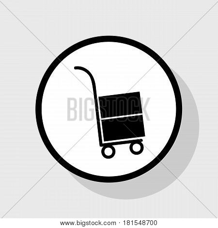 Hand truck sign. Vector. Flat black icon in white circle with shadow at gray background.