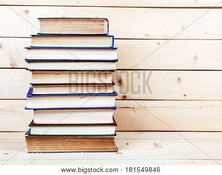 Old books on a wooden shelf. funds for education and
