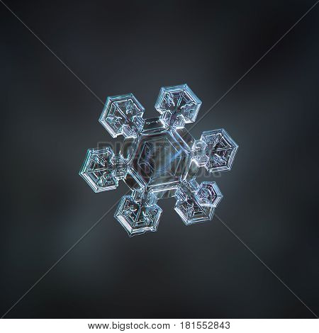 Macro photo of real snowflake: medium size snow crystal of star plate type with six short, broad arms and large, flat central hexagon with simple inner pattern. Snowflake glows on dark cyan blur background.