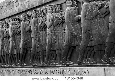 A monochrome close-up of a line of soldiers on the reverse side of the Liverpool Cenotaph.