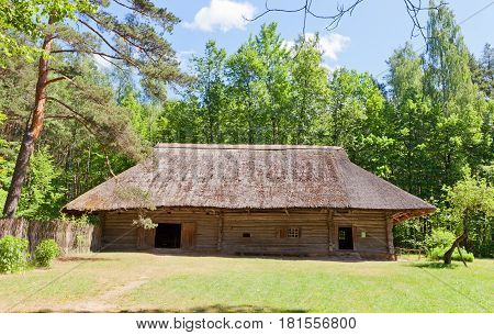 RIGA LATVIA - JUNE 13 2016: Combined threshing dwelling house and school (circa 1670s) of Brezi village of Vidzeme ethnic group. Exhibited in Ethnographic Open-Air Museum of Latvia since 1933