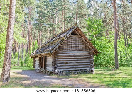 RIGA LATVIA - JUNE 13 2016: Bathhouse with summer kitchen (circa 1840s) of Koderi farmstead of Vidzeme ethnic group. Exhibited in Ethnographic Open-Air Museum of Latvia since 1933