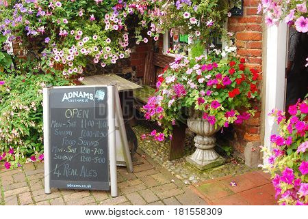 Norwich,England-August 5,2016:Board outside a pub shows the opening hours for the establishment