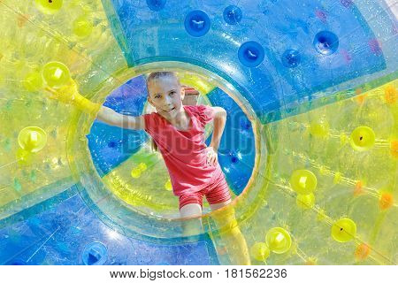 Zorbing. Girl inside the inflatable cylinder outdoor