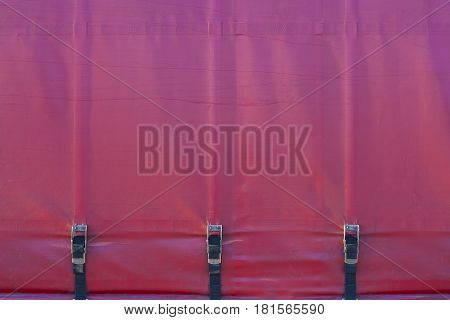 Red tarpaulin trucks wall. texture. abstract background