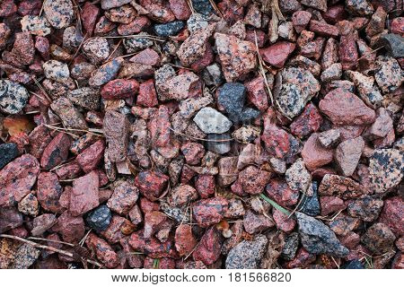 Background of colored rubble on the ground.
