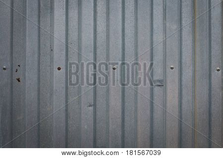 Background of an iron fence with screws.