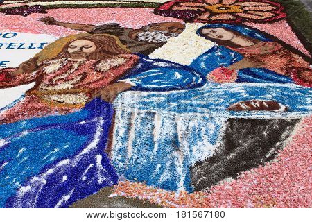 GENZANO ITALY - JUNE 17: Floral Carpet with Jesus Christ and Virgin Mary on June 17 2012 in Genzano Italy. This event takes place every year and every sector honors a specific artist or subject