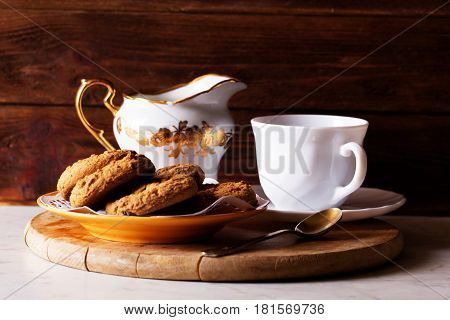 homemade oatmeal raisin cookies with cup of coffee on wooden background.Cookies tea rustic wood background