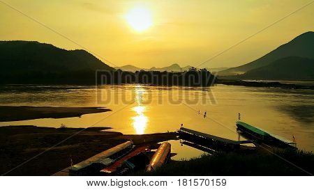 Long tail boats at the port in Mekong river during golden sunset at Kaeng Khut Khu Chaing Khan Loei Thailand