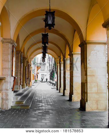 Feb 21 2017 in Lviv Arched stone Colonnade gallery with shadows. Long passage