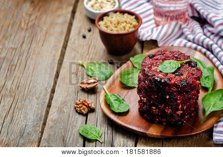 Black beans quinoa beet walnuts burgers with spinach.