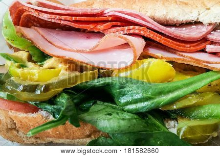 An Italian Sub Sandwich Closeup with Spinach