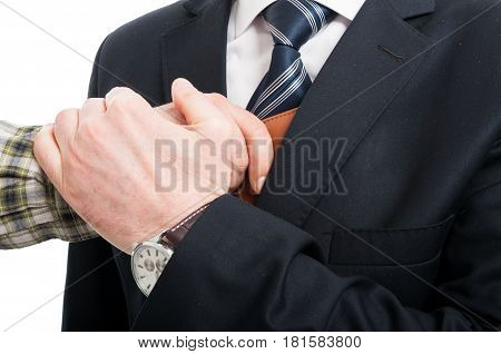 Close-up Of Hand Stealing Wallet From Jacket Pocket