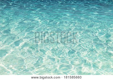 Shining blue water ripple background, close up