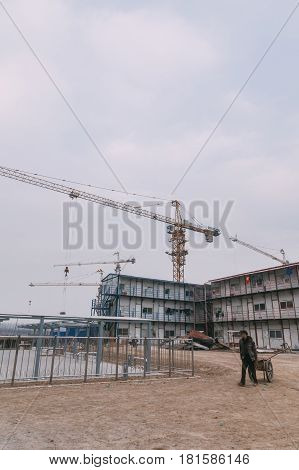 18 Dec,2014 Beijing. Work Activity On A Construction Site In City With Cranes And Workers,building T
