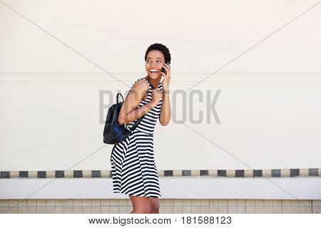 Laughing Young Woman Walking And Talking On Cellphone