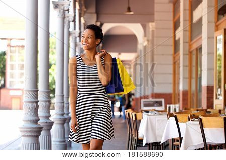 African American Woman Walking With Shopping Bags In The City