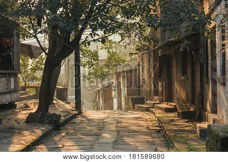 China Chongqing : a traditional village and house Beside the famous travel attractions Ciqikou city of ancient and historical shophouseslocals walking throught old house