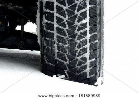 Studless winter tire protector packed with snow detailed