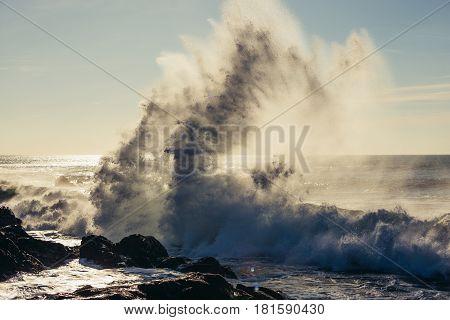 Big waves on Atlantic Ocean seen from beach in Porto Portugal