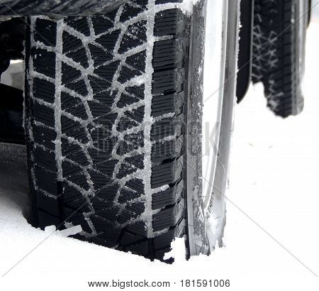 Off road truck wheels on the snow close up stock photo