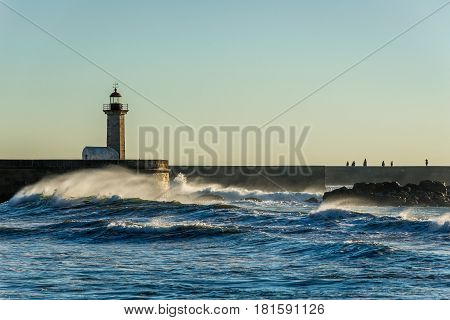 Felgueiras Lighthouse seen from beach in Porto city Portugal