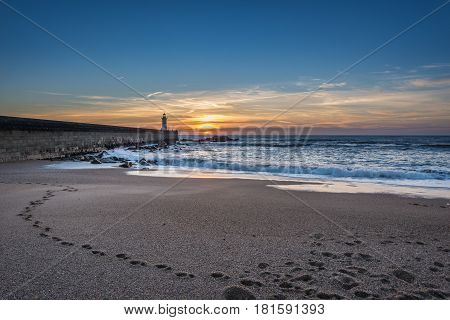 Beach in Foz do Douro parish in Porto. View with breakwater and Felgueiras Lighthouse
