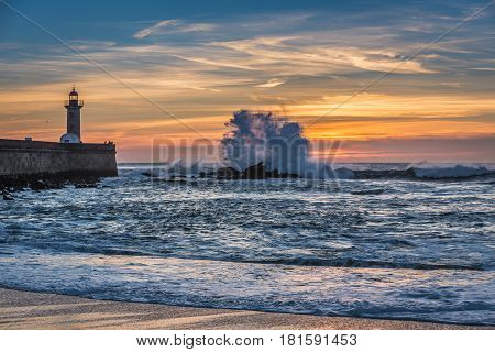 Sunset view with lighthouse in Porto city Portugal. View from Carneiro beach