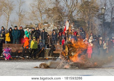Sviyazhsk, Russia - 26 February 2017: burning of winter's effigy - Maslenitsa Event - crowd looking to pagan rite, telephoto