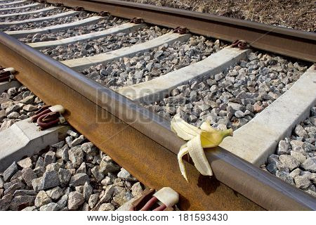 Banana peel on rail way, Humoristic `Sabotage`close up image
