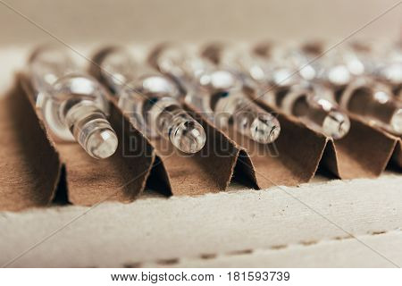 Medical ampoules with medicine or vaccine in a box