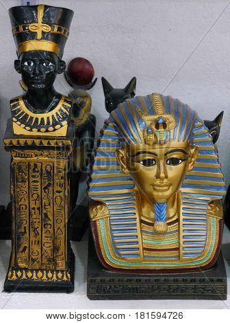 Souvenir copies of Queen Nefertiti and Tutankhamun's death mask on sale in tourist shop, Cairo, Egypt