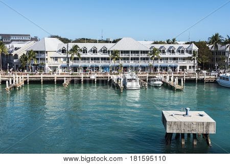 Key West Florida- February 12th 2017: Commercial pier and store fronts and docking facilities at Key West Florida February 12th 2017