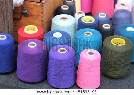 Colorful weaving yarns close up image .