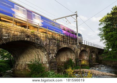A local train passes over the arches of the Six Arches Caravan site at Scorton.
