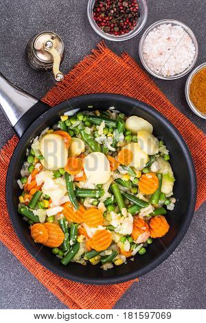 Potato with vegetables, fried in frying pan. Studio Photo