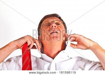 attractive man binding his red neck tie