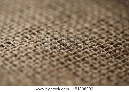 piece of hessian cloth , shallow depth of field to create effect of blur.