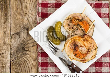Medallions of meat, cooked on the grill. Studio Photo