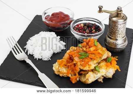 White fish with vegetables, side dish of rice. Studio Photo