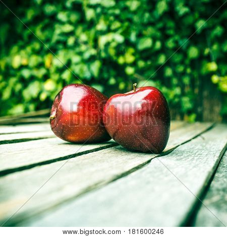 fresh red apple on vintage wooden table