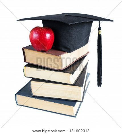 Black graduate hat stack of big books and red apple isolated on white background