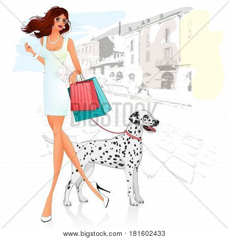 beautiful girl with dog breed Dalmatians and purchases goes through the city